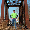 11-28-12<br /> Charlie Skoog<br /> Charlie Skoog stands on the railroad bridge cross the Wildcat Creek. Skoog is part of the Wildcat Guardians which has cleaned up areas along the creek for community gardens and he is part of a team working on connecting the Nickel Plate trail to Kokomo.<br /> KT photo | Kelly Lafferty