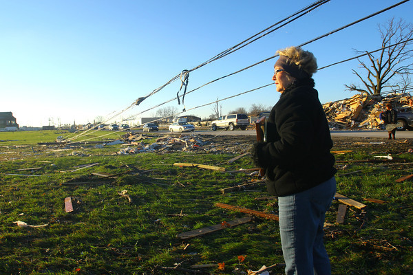 11-18-13  --  Tornado Followup. Phyllis Rawlins goes through items in her house that was destroyed on Ricketts.<br />   KT photo | Tim Bath
