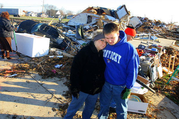 11-18-13  --  Tornado Followup. Phyllis Rawlins goes through items in her house that was destroyed on Ricketts. Her grandson, Hayden Rawlins, showed up to help and gave her a hug.<br />   KT photo | Tim Bath