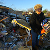 11-18-13  --  Tornado Followup. Phyllis Rawlins goes through items in her house that was destroyed on Ricketts. She found a photo album that was open to the page with her late husband. He build the house 8 years ago for there retirement and passed away last year.<br />   KT photo | Tim Bath