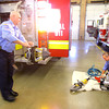 11-14-13  --  Peru Fire Department --  Firefighter Herb Hunt and Capt Erick Hawk checking the rescue equipment.<br />   KT photo | Tim Bath