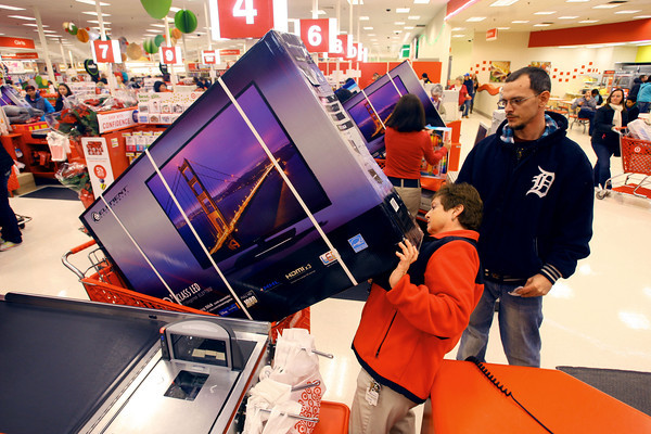 11-28-13  --  Shopping begins on Thanksgiving. Josh Lee purchases a 50 inch TV at Target with cashier Cindy Shrader scanning the product.<br />   KT photo | Tim Bath