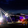 The tornado took down power lines all over Kokomo with workers replacing lines along South Webster on Monday evening.<br />   KT photo   Tim Bath