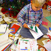 11-8-13  --  Ryan Beining with some of the thousands of Christmas Cards that he has received from all over the world. He has been terminally ill with cancer for some time and has expressed love of Christmas.<br />   KT photo | Tim Bath