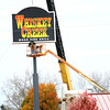 11-11-13  --  Signs being removed from Whiskey Creek. There last day of operation was Sunday Nov. 10.<br />   KT photo | Tim Bath
