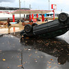 An overturned car sits in the parking lot near Rally's.<br /> KT photo | Kelly Lafferty