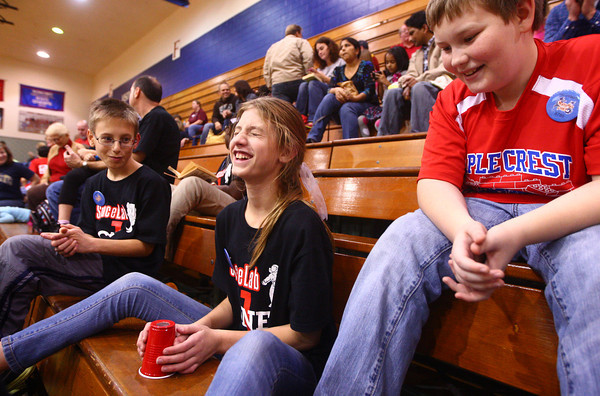 11-9-13<br /> Lego league tournament<br /> While waiting for their turn to compete in the Lego League tournament, Jerzie Eagle (center) laughs as she tries to get the hang of the cup game while Ethan Smith and Brayden Mickle watch.<br /> KT photo | Kelly Lafferty