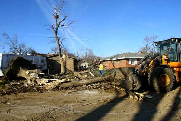 Tornado that hit Cedar Crest subdivision left a path of destruction that Kokomo city employees and voluteers had to remove. Pontiac Drive is cleared on Tuesday of some debris.<br />   KT photo | Tim Bath