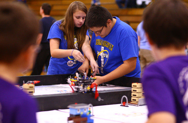 11-9-13<br /> Lego league tournament<br /> Isabelle Baker and Sam Maldonado make changes to their robot during the Lego League tournament at Kokomo High School.<br /> KT photo | Kelly Lafferty