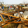 Tornado that hit Cedar Crest subdivision left a path of destruction that voluteers helped to remove. Buick Lane is cleared on Wednesday of some debris.<br />   KT photo | Tim Bath