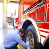 11-14-13  --  Peru Fire Department --  Firefighter Greg Hunt checking air pressure on the ladder truck tires.<br />   KT photo | Tim Bath