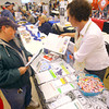 11-8-13  --  Veterans Stand Down event at the VFW post. Diane Livengood, an Airforce Veteran,  talks with Katina Dimitro, from Career Development Financial Counseling Services, who was manning one of the many booths available for vets to gather information.<br />   KT photo | Tim Bath