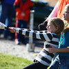 11-9-13<br /> Punkin Chunkin and TechKNOWfest<br /> Ella Wade holds Lillie Wade as she pulls the slingshot back to release a little pumpkin during Punkin Chunkin at Ivy Tech on Saturday.<br /> KT photo | Kelly Lafferty