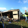 11-23-13<br /> Tornado cleanup on Bell St.<br /> Rick Rhodes helps clean up on Bell Street on Saturday morning.<br /> KT photo | Kelly Lafferty