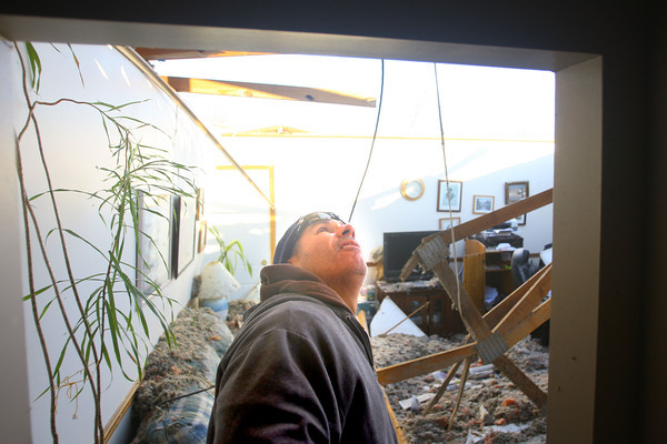 ndiana Farmers Mutual Insurance Company claims representative David Bafia checks out the damage and the remains of Jean Sanner's family room after the tornado came through. Her house on Buick Lane in Cedar Crest was assessed as a total loss.<br />   KT photo   Tim Bath