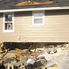 11-18-13  --  Tornado Followup.  The home of Drew Larrick and housemate Taylor Glenna. They were in the basement under a matress when the tornado lifted their house off the foundation. Drew yell out to family and friends to help him move items out of the house.<br />   KT photo | Tim Bath