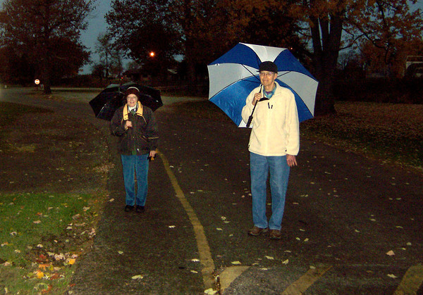11-6-13<br /> Walkers along the road and walking path in the Tipton City Park.<br /> KT photo | Ken de la Bastide