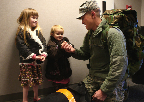 11-18-13<br /> Homecoming of the 434th Air Refueling Wing to Grissom<br /> Kevin Peters spends time with his two daughters Jenny and Maggie, after he returned to Grissom from a deployment with the 434th Air Refueling Wing in southeast Asia.<br /> KT photo | Kelly Lafferty