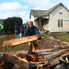 11-23-13<br /> Tornado cleanup on Bell St.<br /> Many volunteers help clean up the debris left behind by the tornado on Bell Street on Saturday morning.<br /> KT photo | Kelly Lafferty