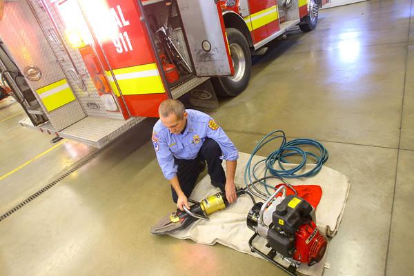 11-14-13  --  Peru Fire Department --  Capt Erick Hawk checking Hurst rescue equipment.<br />   KT photo | Tim Bath
