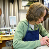 11-25-13  --  Tarin Serra changes a sustomer's watch battery at Palmer's Jewelers. Palmer's has been a staple downtown since 1944.<br />   KT photo | Tim Bath