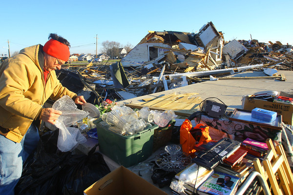 11-18-13  --  Tornado Followup. Phyllis Rawlins goes through items in her house that was destroyed on Ricketts. Ben Eikenberry was helping to box things up that were savageable.<br />   KT photo | Tim Bath