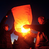 11-9-13<br /> Cancer Benefit<br /> Cassy Taylor and her fiancee Jon, light a paper lantern at the Howard County fairgrounds.<br /> KT photo | Kelly Lafferty