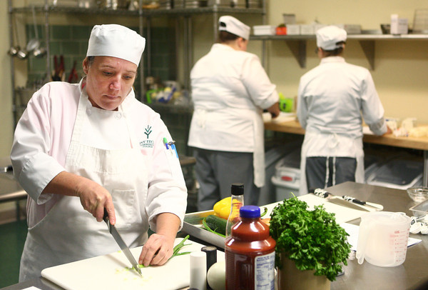 11-8-13<br /> Cooking class at Ivy Tech in Peru<br /> Becky Proctor works on preparing ingredients for the soup she was making in her cooking lab class at Peru's Ivy Tech.<br /> KT photo | Kelly Lafferty
