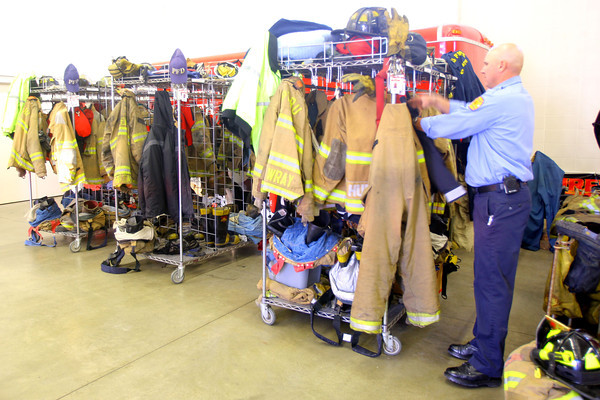 11-14-13  --  Peru Fire Department -- Firefighter Herb Hawk getting his gear from the storage rack.<br />   KT photo | Tim Bath