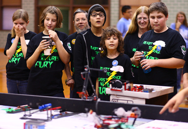 11-9-13<br /> Lego league tournament<br /> The Robo-raptors watch their robot make its way across the table during the Lego League tournament.<br /> KT photo | Kelly Lafferty