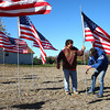11-9-13<br /> Michael Poulimas and Don Hitchcock put up flags that will be part of a military display at Poulimas' home in Sharpsville.<br /> KT photo | Kelly Lafferty