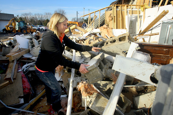 Marci May looks through the rubble of her business on East Lincoln Road for any salvageable items. She had a party going on during the tornado with 10 little girls that all piled in the bathroom just before the walls came down.<br />   KT photo   Tim Bath