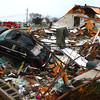 A car sits halfway in a basement at a leveled home near Home Avenue and Hoffer Street.<br /> KT photo | Kelly Lafferty