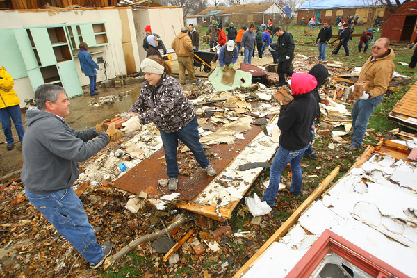 11-22-13  --  Ivy Tech employees take Friday afternoon to voluteer cleanup in the Cedar Crest subdivision. <br />   KT photo   Tim Bath