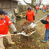 11-22-13  --  Voluteers from Lowes cleanup in the Cedar Crest subdivision. After helping out a fellow employee clean up his tornado ravaged yard they made their way through the subdivision helping whomever they could. Jennifer Sayre, Karla May and Julia Biggs clear debris at a house on Mohr Drive.<br />   KT photo | Tim Bath