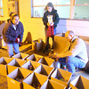11-21-13  --  Shannon Robinson, Nicole Downing and Gary Purcell sort canned goods that have come into the United Way tornado relief site at the old Kokomo Spring company on Wheeler Street just west of Home Avenue.<br />   KT photo | Tim Bath