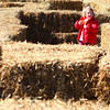 11-9-13<br /> Punkin Chunkin and TechKNOWfest<br /> Maggie Weber makes her way through a hay bale maze at Punkin Chunkin on Saturday.<br /> KT photo | Kelly Lafferty