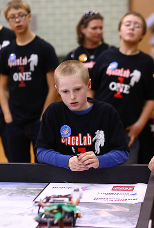 11-9-13<br /> Lego league tournament<br /> Nathanael Elkin watches his robot during the Lego League tournament at Kokomo High School.<br /> KT photo | Kelly Lafferty