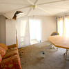 11-18-13  --  Tornado Followup.  The home of Drew Larrick and housemate Taylor Glenna. They were in the basement under a matress when the tornado lifted their house off the foundation. The house is all twisted and warped from the move.<br />   KT photo | Tim Bath