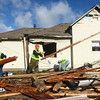 11-23-13<br /> Tornado cleanup on Bell St.<br /> NIPSCO volunteers Cyrena Staller, Phil Williams, and Marty Bradley help clean up on Bell Street Saturday morning.<br /> KT photo | Kelly Lafferty