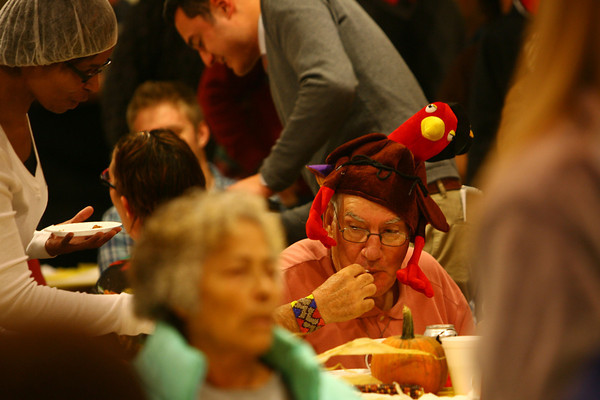 11-28-13  --  Annual Thanksgiving Day meal at Grace United Methodist Church put on by the Kokomo Rescue Mission. Vernon Daniels eats his meal while wearing a turkey hat that he won last week playing turkey bowling.<br />   KT photo | Tim Bath