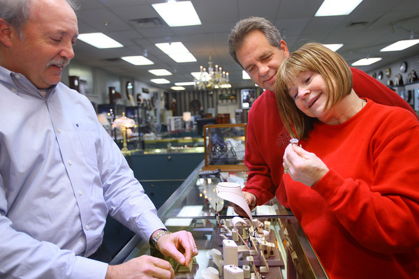 11-25-13  --  Palmer's Jewelers co-owner Mike Freed works with customers David and Susie Bohmer at the downtown store at the corner of Sycamore and Main Streets.<br />   KT photo | Tim Bath