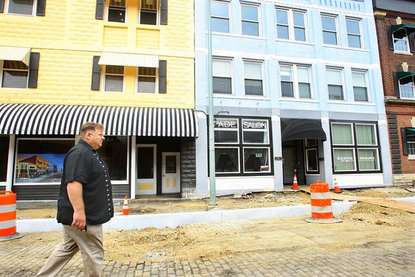 5-29-14   --- Developer Jeff Broughton is fixing up the Buckeye Street buildings between Jefferson and Jackson. Broughton walking north on Buckeye. --<br />   Tim Bath | Kokomo Tribune
