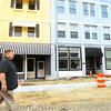 5-29-14   --- Developer Jeff Broughton is fixing up the Buckeye Street buildings between Jefferson and Jackson. Broughton walking north on Buckeye. --<br />   Tim Bath | Kokomo Tribune