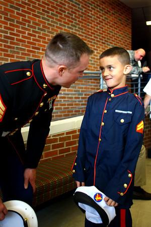 11-11-14<br /> After the Veterans Day program at Eastern Elementary School Marine Chad Hewitt talks with his son Ian Hewitt.<br /> Tim Bath | Kokomo Tribune