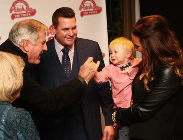 11-22-14 Tommy John gives a high five to Jack Thatcher, son of Joe Thatcher (center) and Katie Thatcher (right). Kelly Lafferty Gerber | Kokomo Tribune