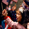 11-11-14<br /> Durng the Veterans Day program at Eastern Elementary School Olivia Gilbertee and other second graders wave flags.<br /> Tim Bath | Kokomo Tribune