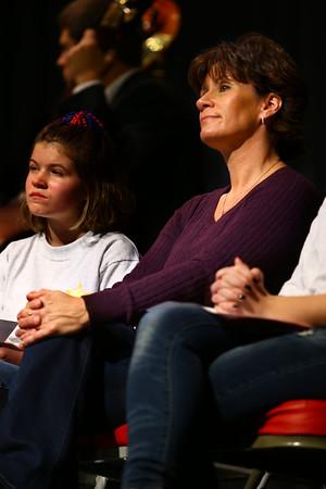 11-11-14<br /> Teri Rose, who lost her son Pfc Neil Simmons in 2007 in the Iraqi War, speaks at the Veterans Day program at Kokomo High School.<br /> Tim Bath | Kokomo Tribune