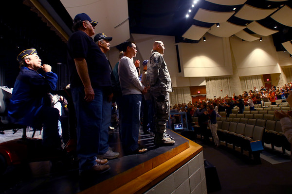 11-11-14<br /> At the beginning of the Veterans Day program at Eastern Elementary School the veterans rise up out of the orchestra pit to be introduced.<br /> Tim Bath | Kokomo Tribune