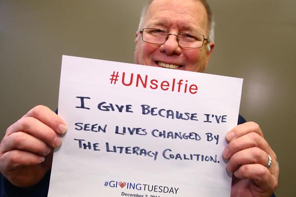 Unselfie for #GivingTueday with Bob Stephenson, executive director of the Literacy Coalition on Wednesday, Nov. 26, 2014.<br /> Tim Bath | Kokomo Tribune